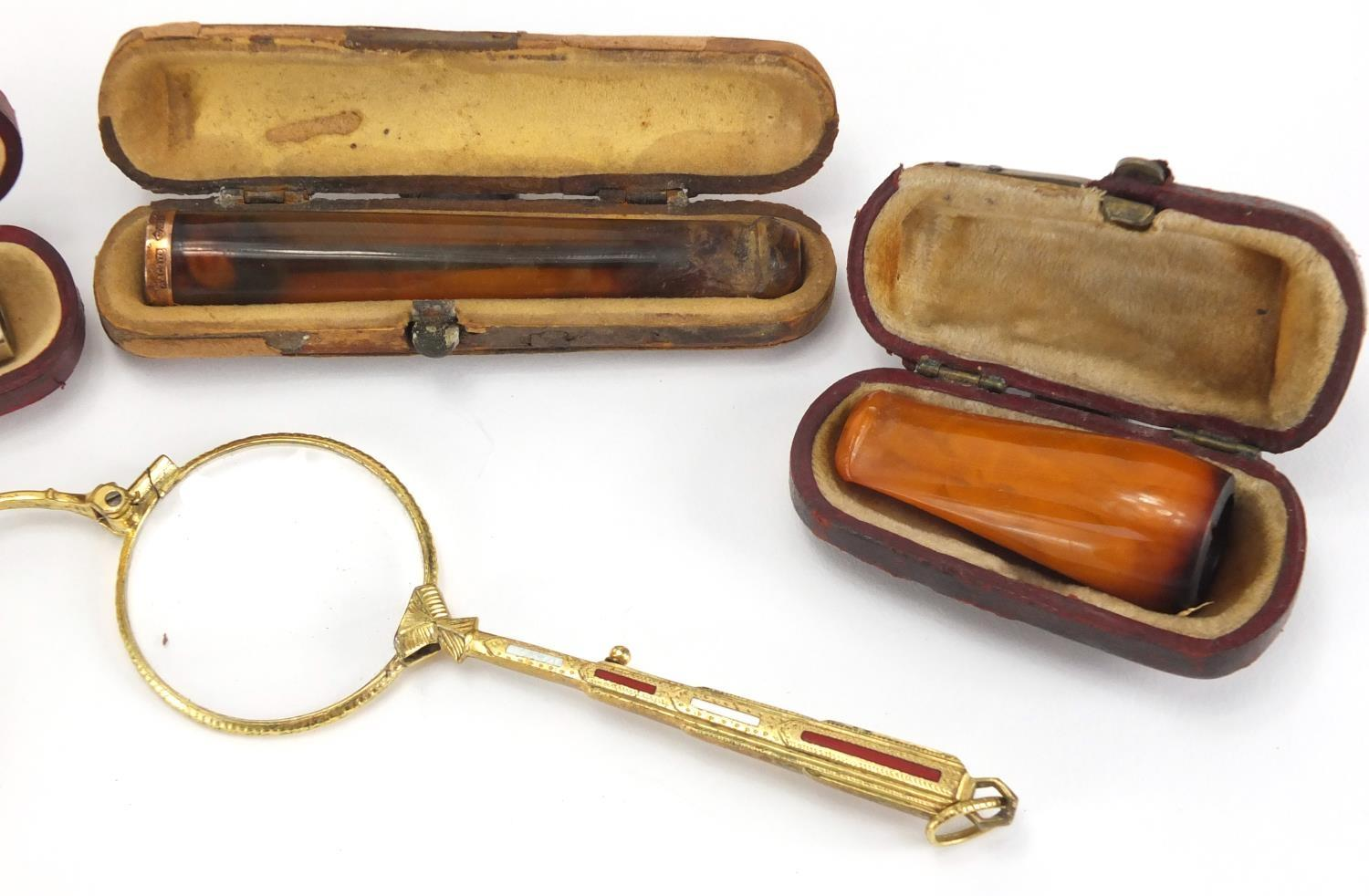 Lot 50 - Pair of gilt metal and enamel folding lorgnettes, together with three amber coloured cheroots, one