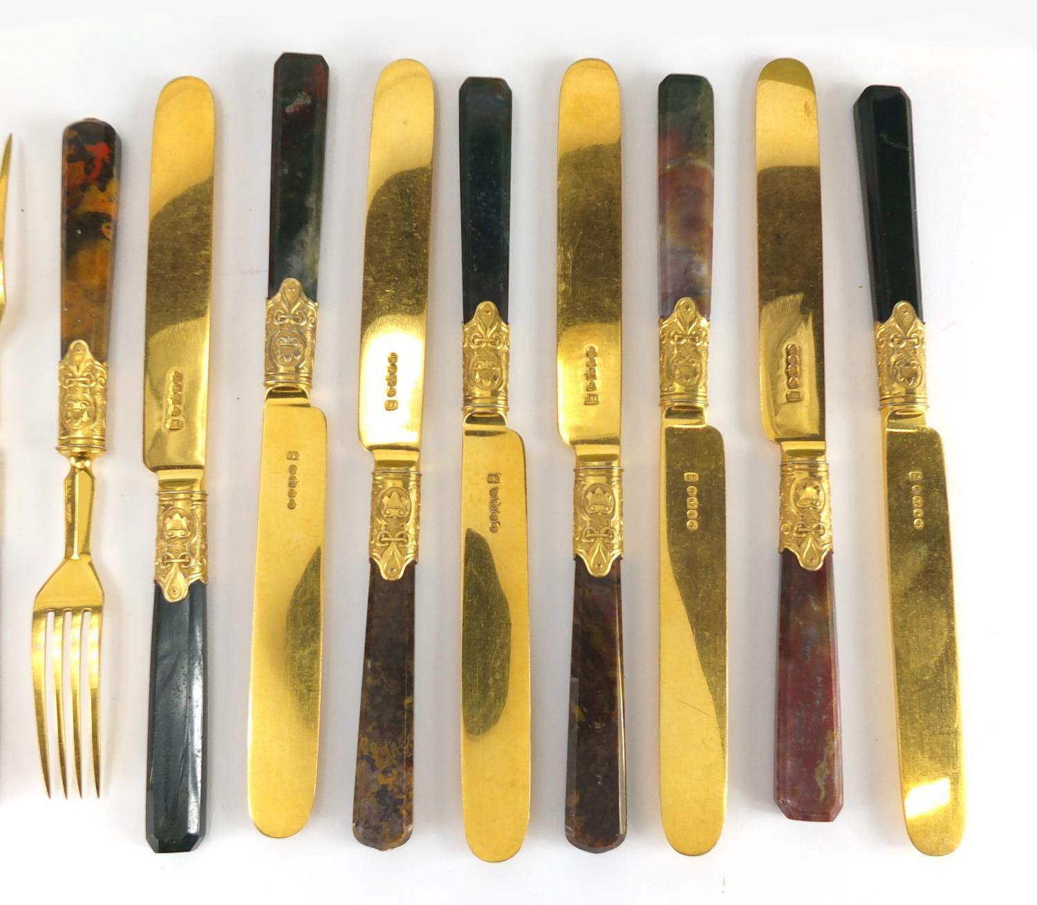 Lot 57 - Set of eight Scottish agate handled knives and forks, with gilt silver plated blades, the knives