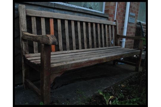 A 20th Century Teak Wood Garden Bench Having Slatted Seat And Back