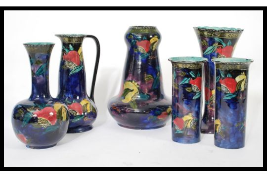 A Group Of Six Ruben Ware Lustre Ceramics To Include Vases And Bowls