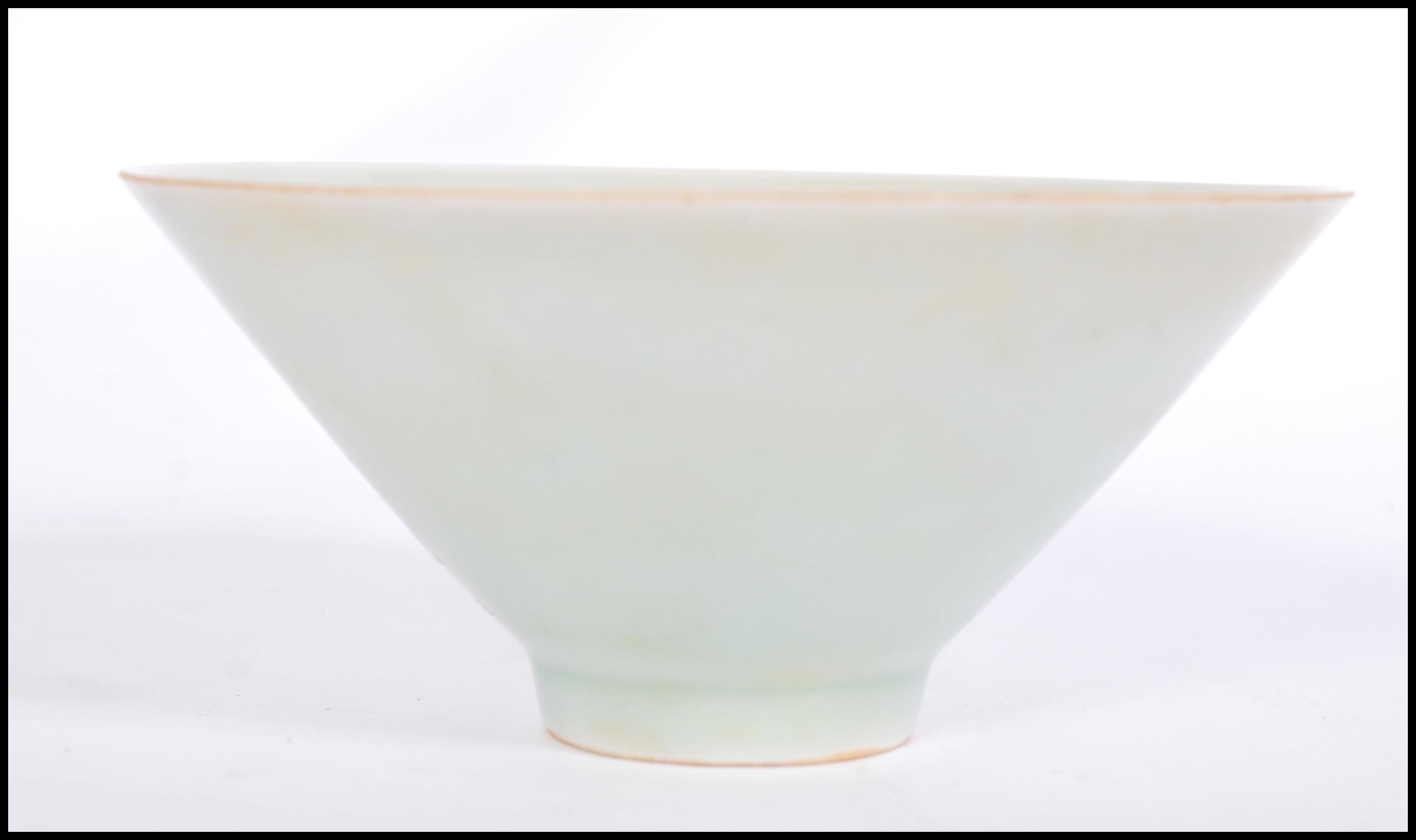 Lot 48 - A believed antique Chinese Celadon glaze bowl of conical form raised on small circular foot.