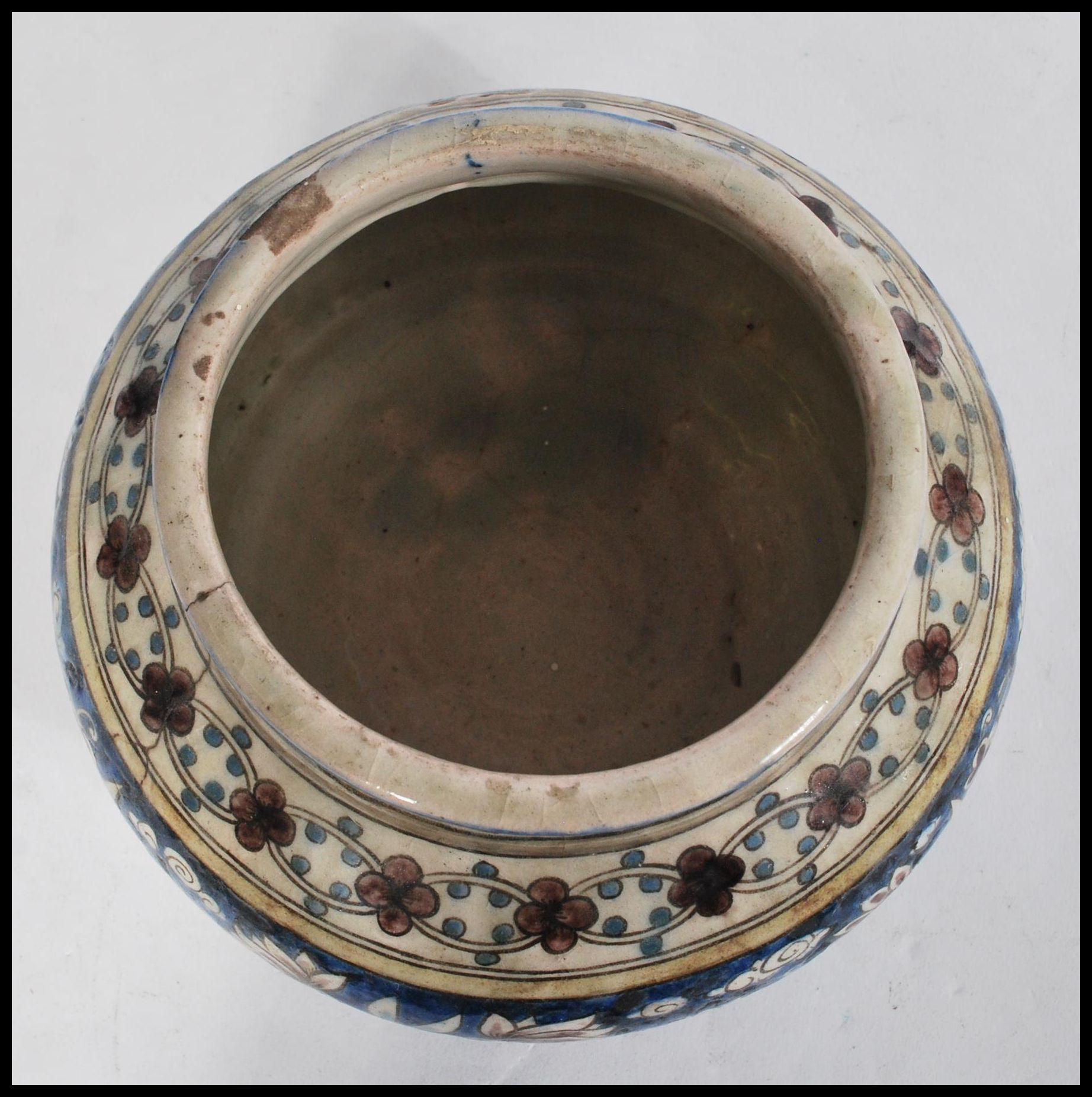 Lot 11 - A 19th century Islamic Middle Eastern pottery Faience bowl of bulbous form having hand painted
