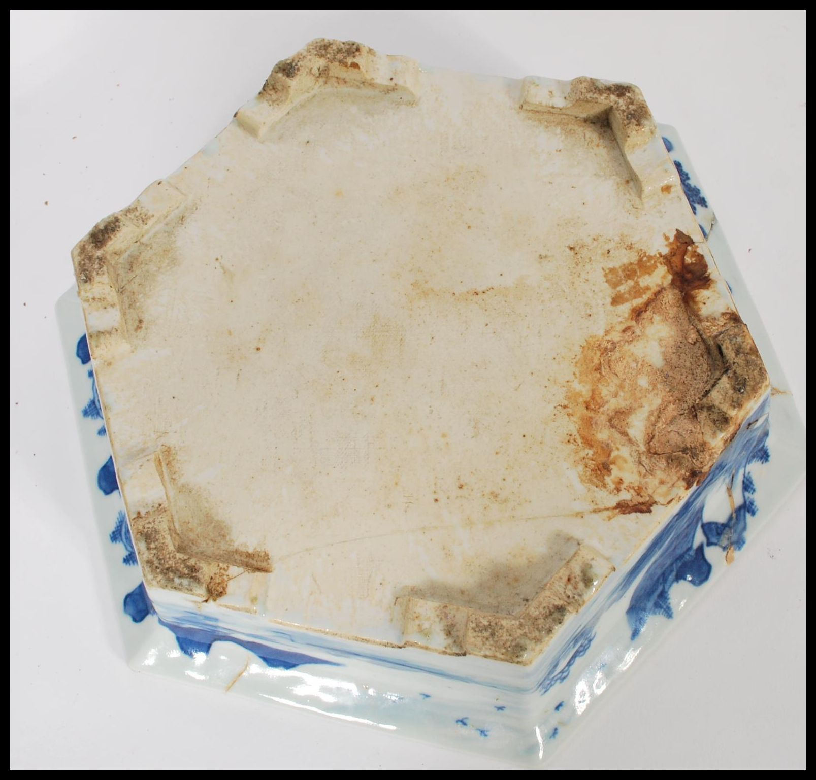 Lot 18 - An 19th century blue and white ceramic Chinese jardiniere and stand having a hexagonal shape. Hand