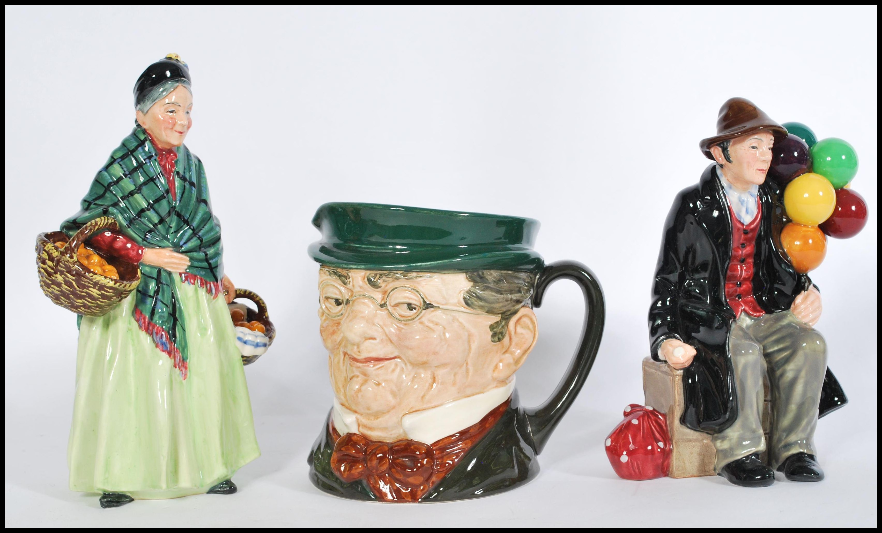 Lot 25 - A collection of Royal Doulton ceramics to include Orange Lady HN1953 RD812548, Balloon Man H1954