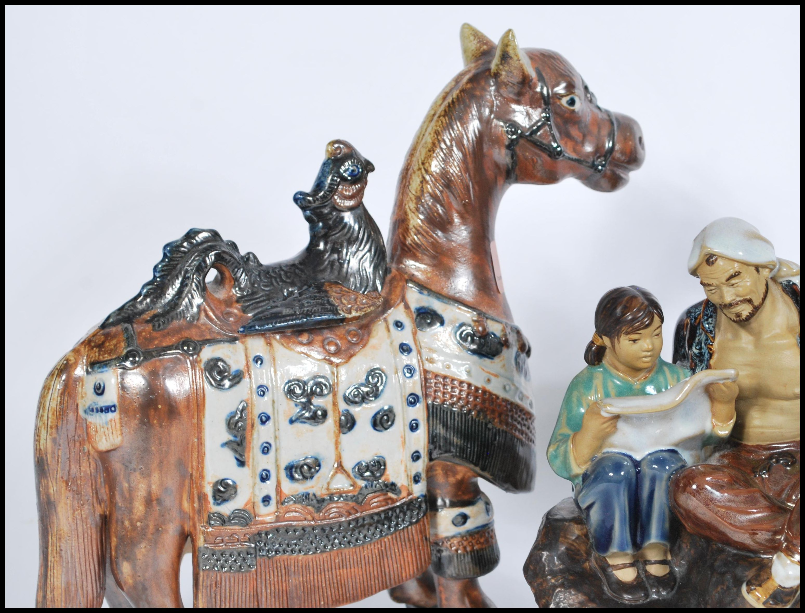 Lot 39 - A 20th Century ceramic Tang Dynasty style War Horse, the horse surmounted by a Phoenix, together