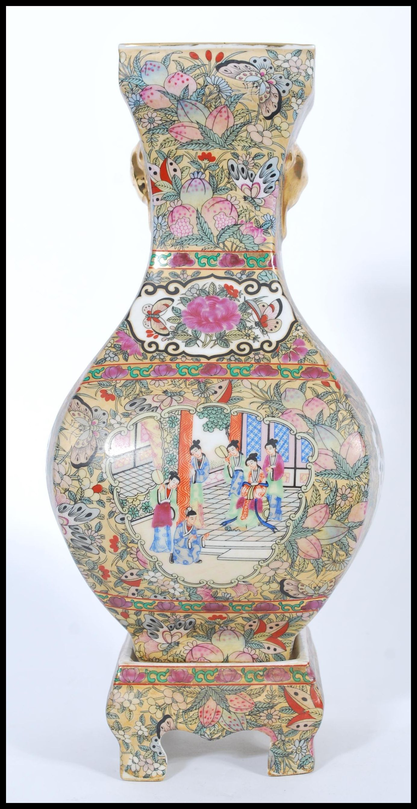 Lot 4 - A Chinese Qianlong mark vase on stand. The bulbous square vase having hand painted scenes of court