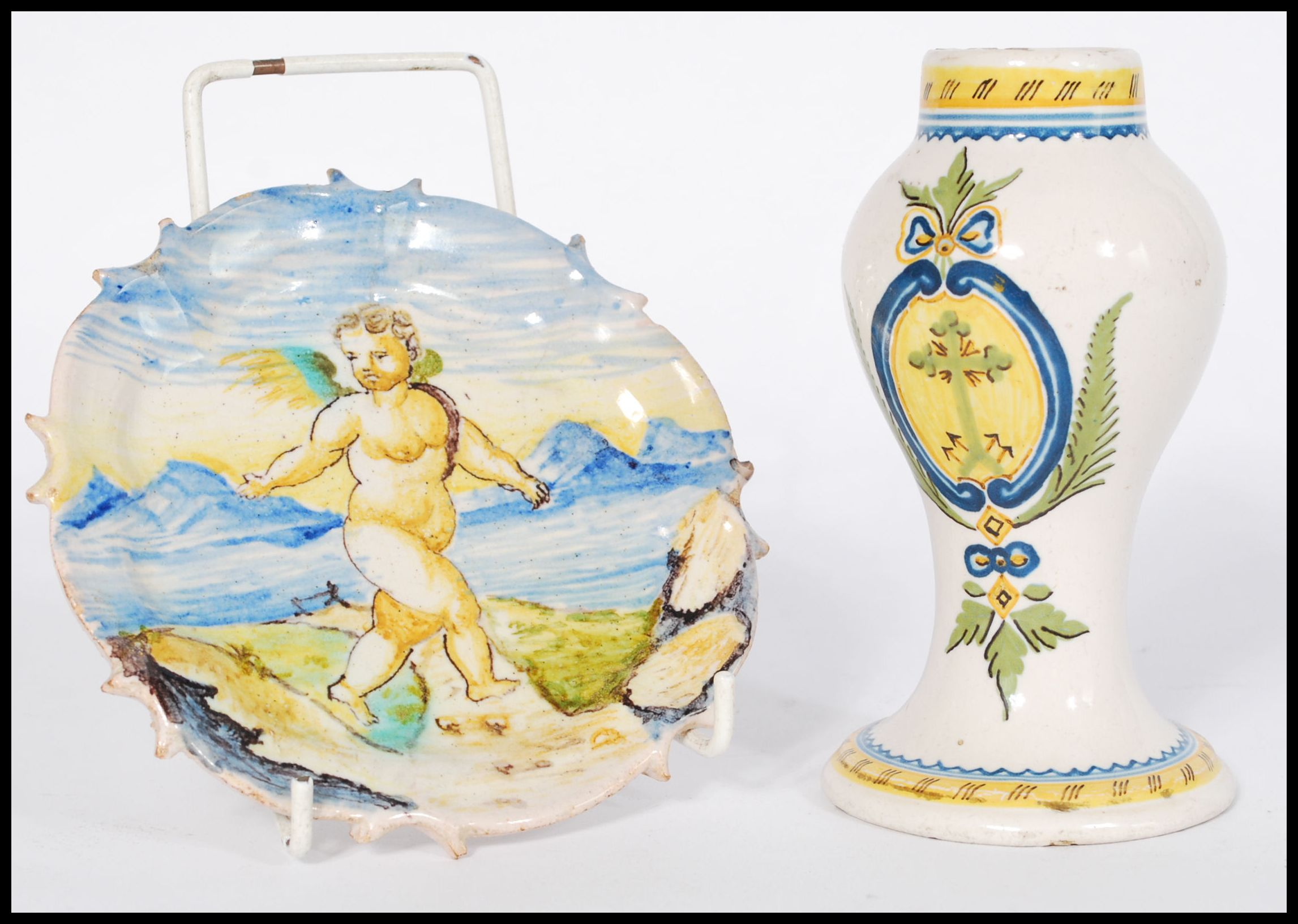 Lot 56 - An early 19th century Italian Faience vase having armorial decoration along with a similar plate