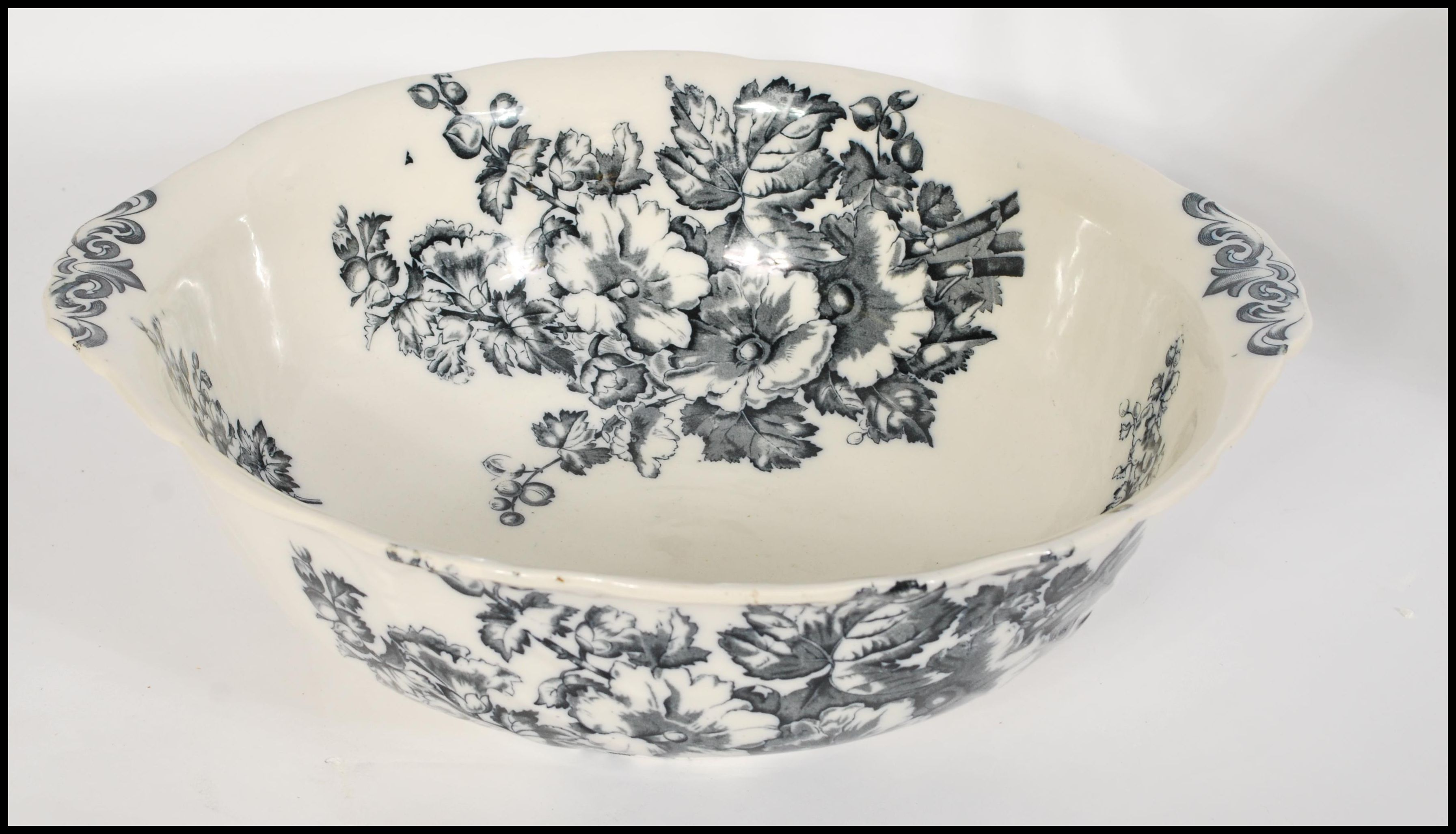Lot 40 - A Victorian ceramic washbowl and jug set in the ' Hollyhock ' pattern by S Bridgwood & Sons.