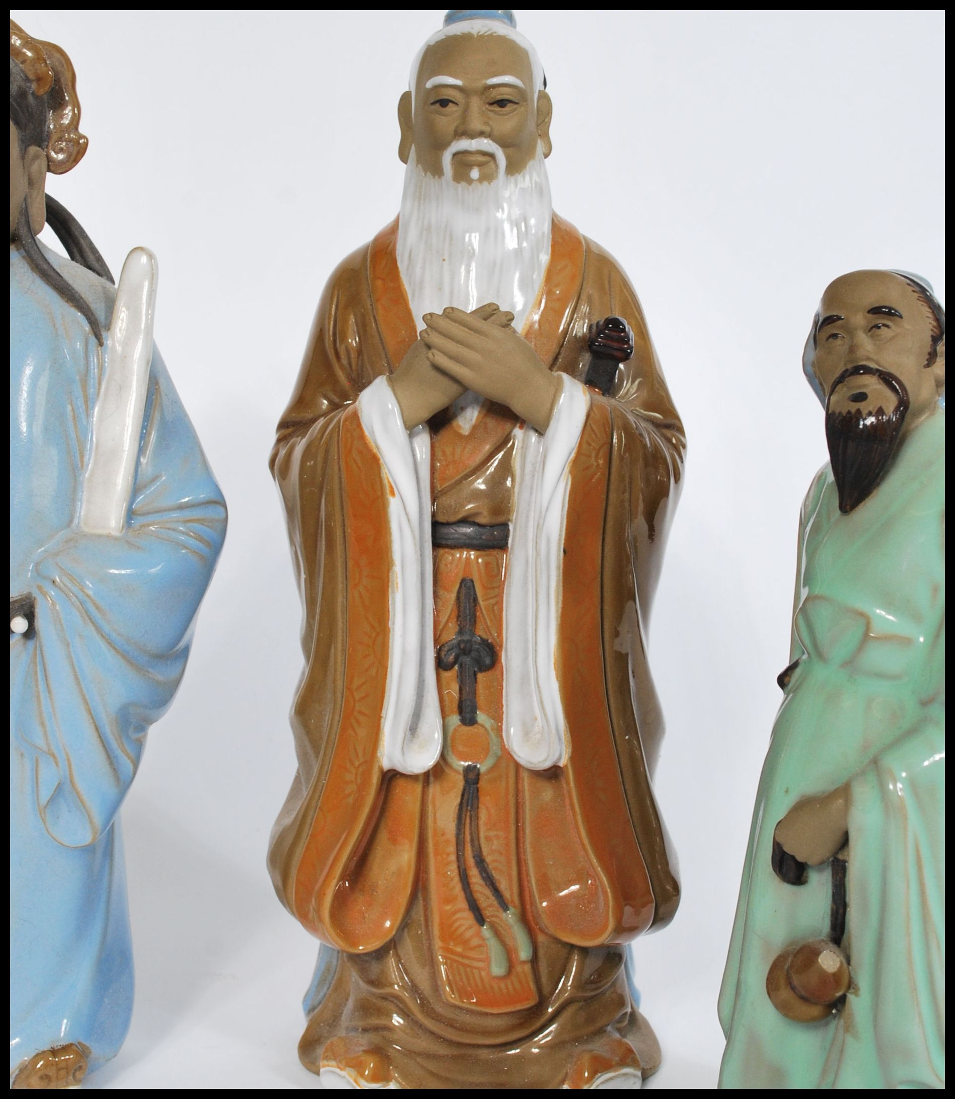 Lot 55 - A group of five 20th century Oriental Chinese and Japanese pottery and ceramic figurines of