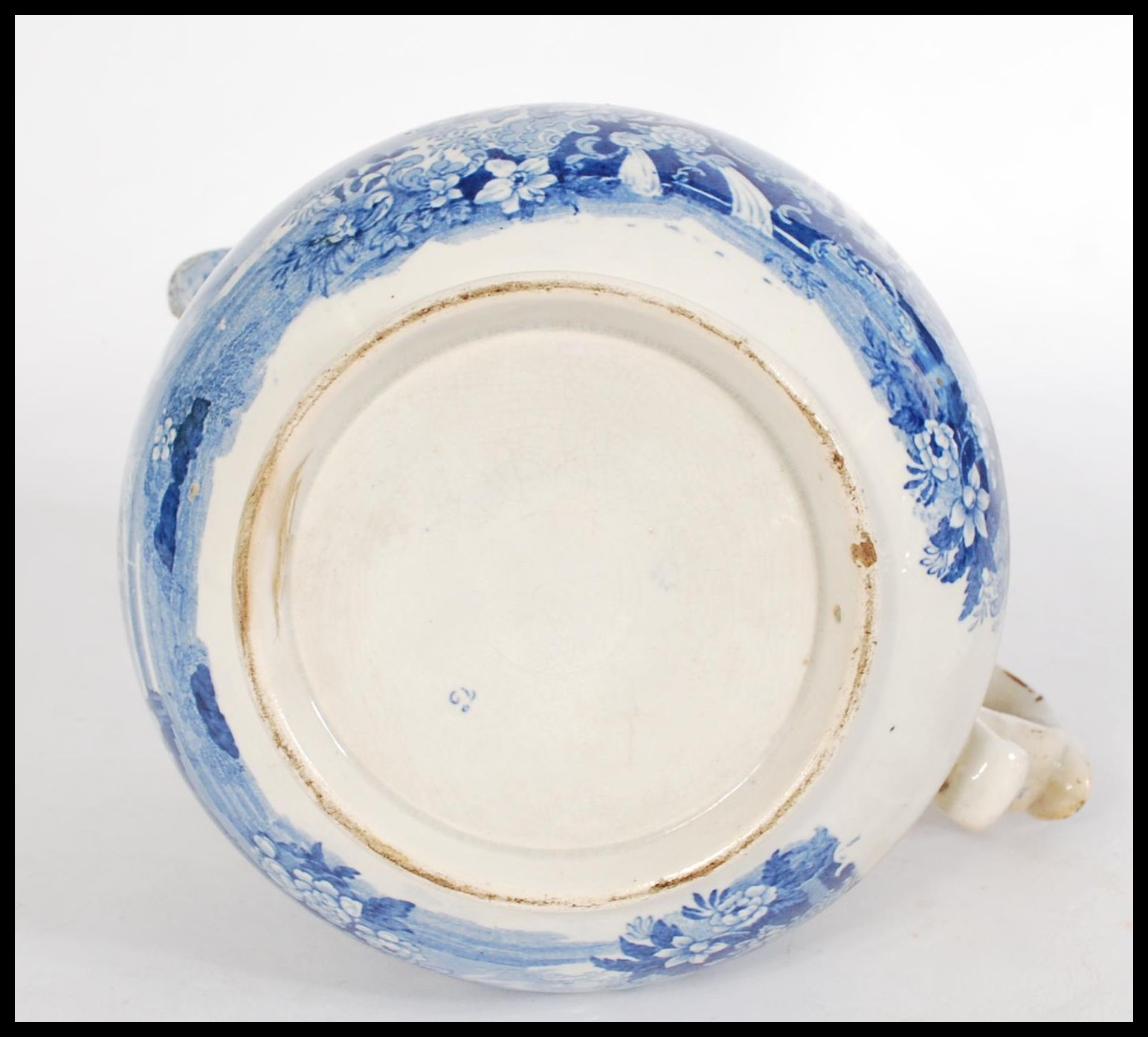 Lot 17 - A 19th century Staffordshire Pearlware jug having a scrolled shaped handle with a blue and white