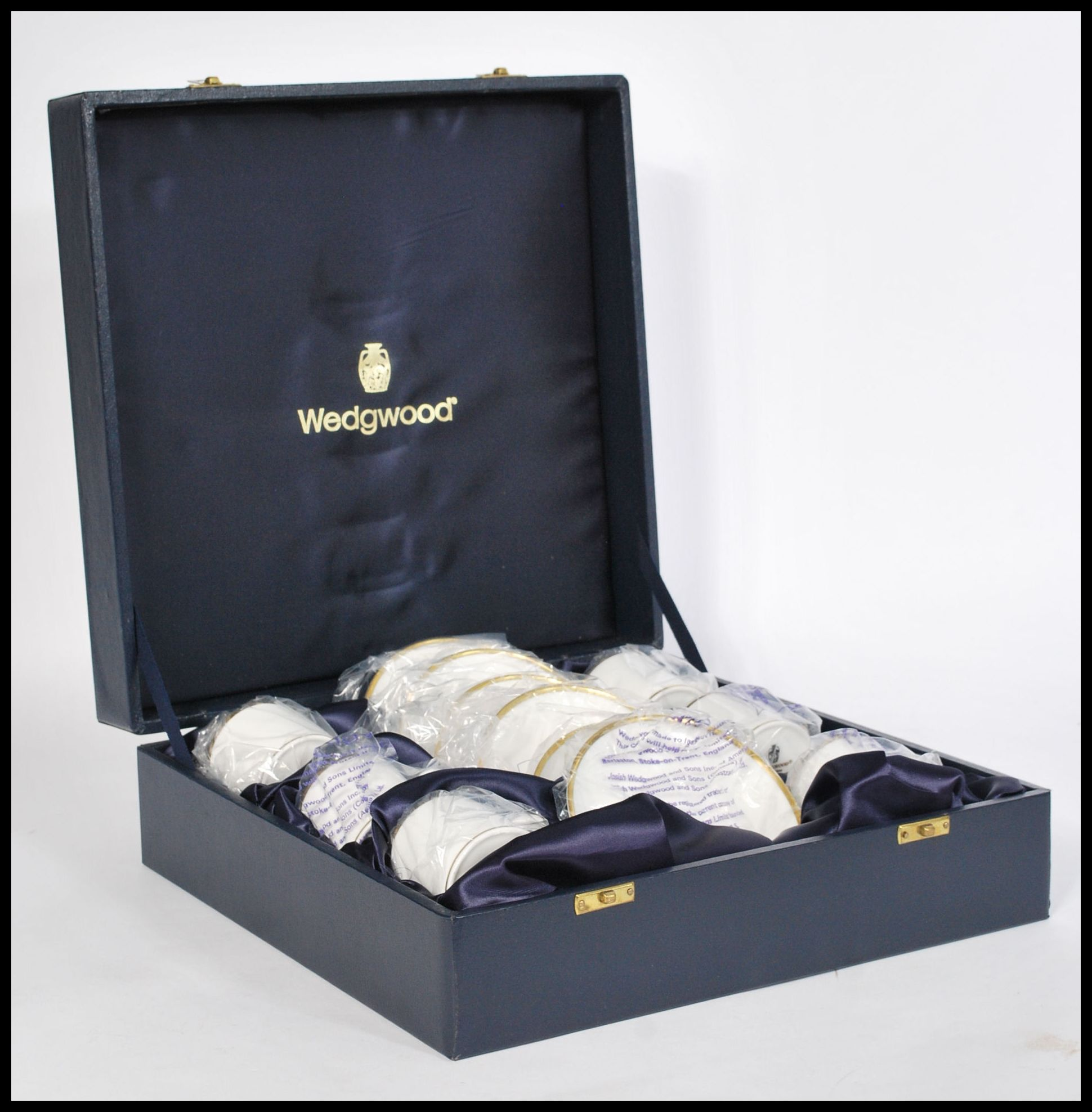 Lot 58 - An unused six persons presentation coffee service by Wedgwood, the hinged case opening to reveal six