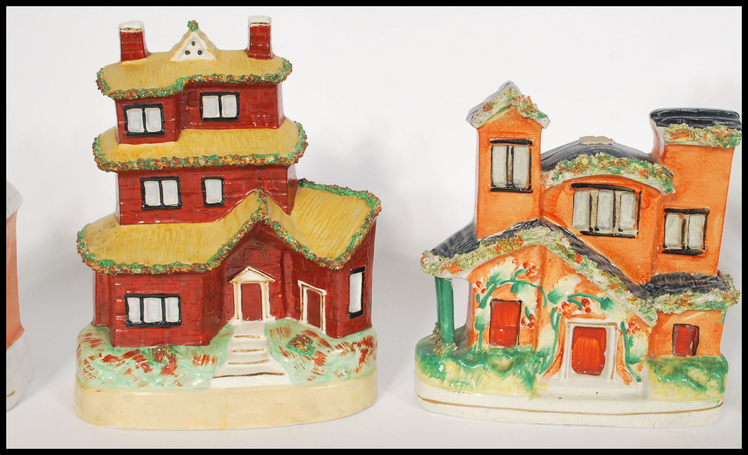Lot 60 - A selection of Staffordshire cottage's dating from the 19th century to include some money box