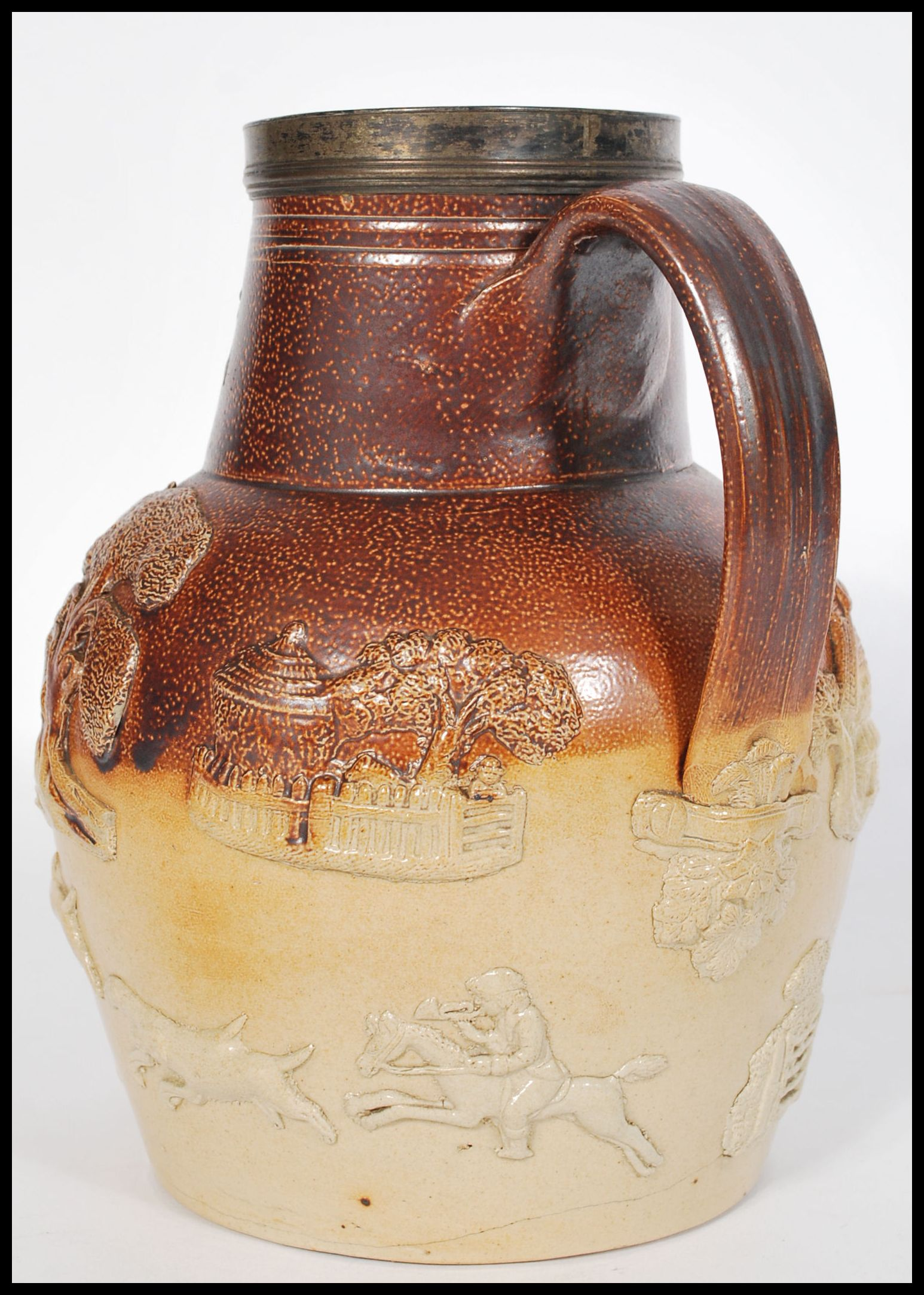 Lot 1 - An early 19th century Salt Glazed Stoneware ewer jug by Vauxhall pottery London. The two tone jug of