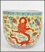 Lot 43 - A large 19th century Chinese brush pot / vase having famille Juane enamelled ground with