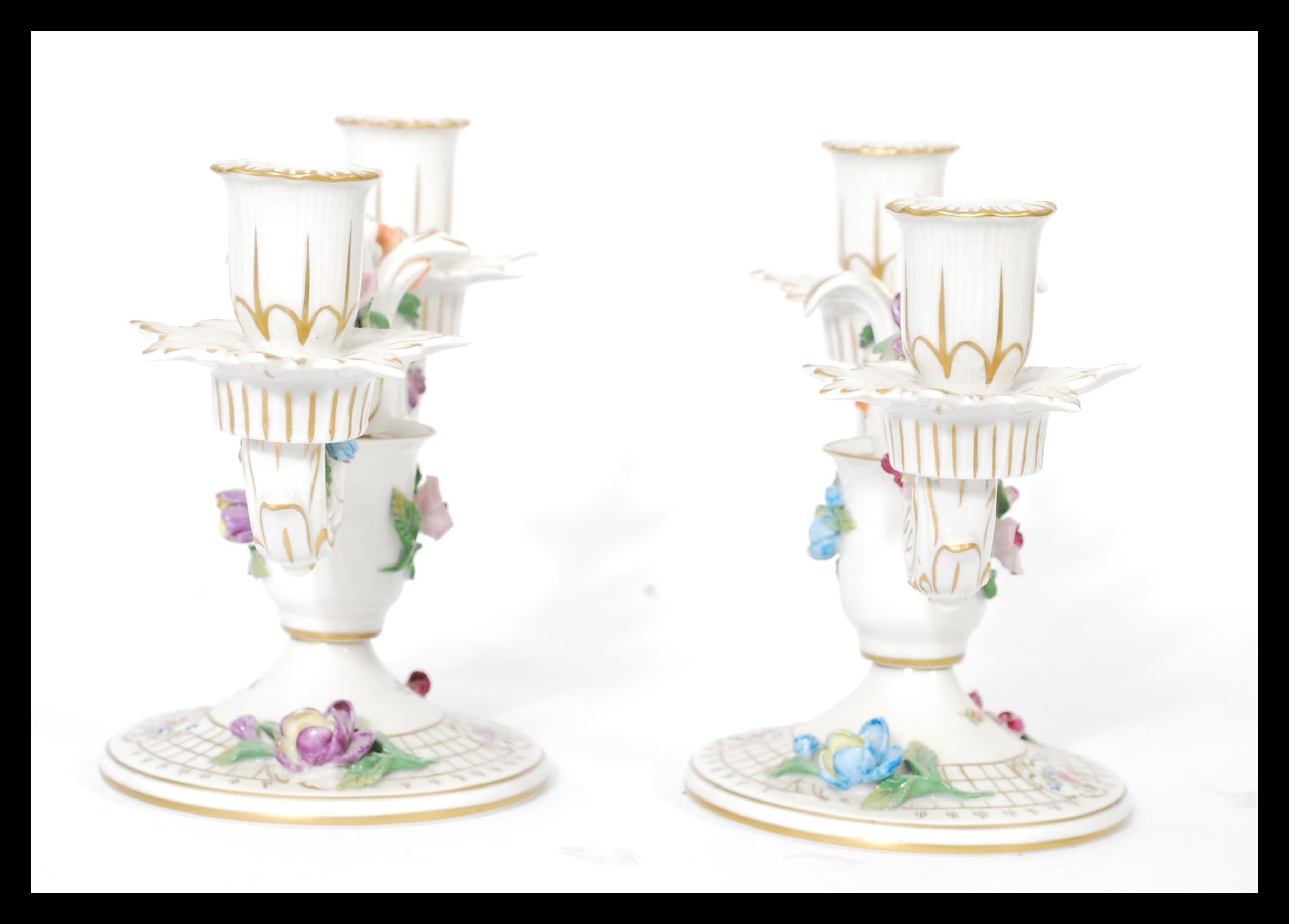 Lot 15 - A pair of Dresden porcelain double sconce candelab