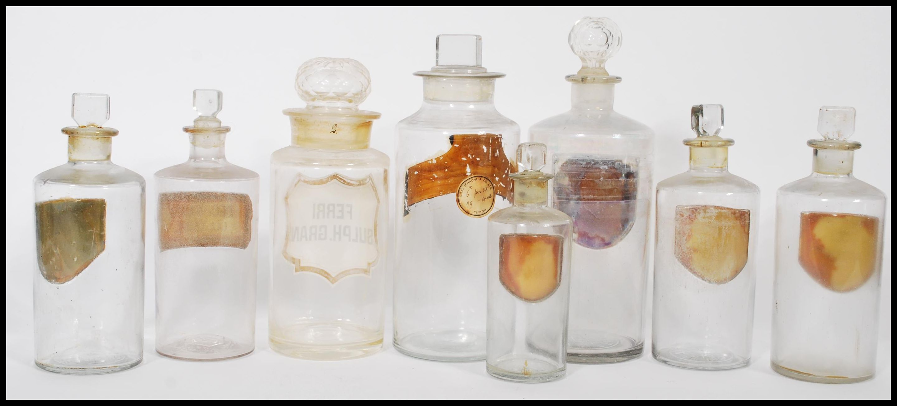 Lot 10 - A fantastic group of eight 19th century Victorian glass apothecary chemist medicine storage jars