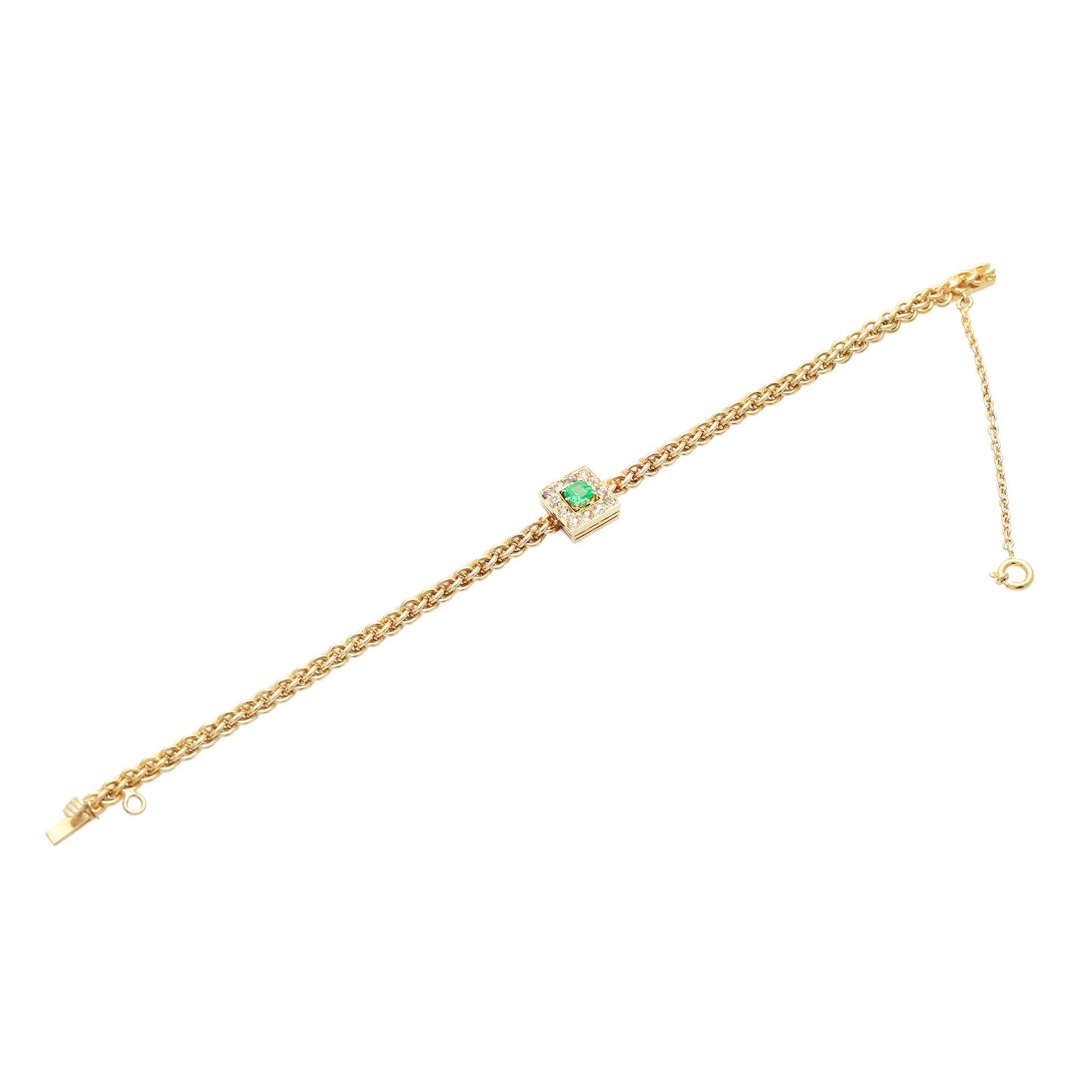 Los 128 - Armkette mit Smaragd im Mittelteil, Russl. GG 14K, Kette als Ösengeflecht, Smaragd im Achtkant