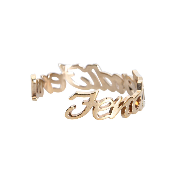 Lot 57 - FENDI Modeschmuck-Armspange.Goldfarbene Hardware in Logoschriftzug. Durchmesser 6cm. Box anbei.
