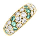 An 18ct gold diamond and emerald ring. The pave-set diamond tapered panel, with circular-shape