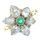 An emerald and diamond floral ring. The circular-shape emerald, with pear-shape diamond petal