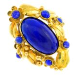 A 1970s 18ct gold lapis lazuli ring. The oval lapis lazuli cabochon collet, with circular lapis