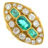 An emerald and diamond cluster ring. Of marquise-shape outline, the graduated rectangular-shape