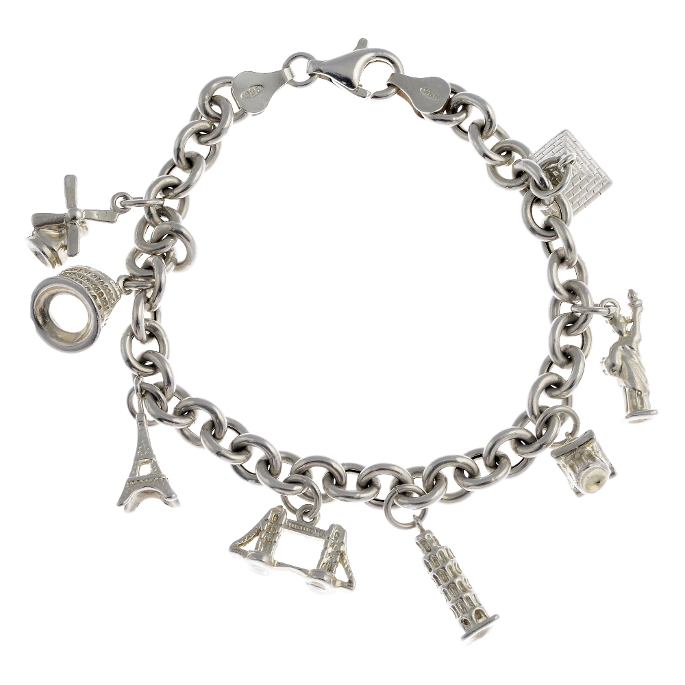 Lot 10 - Eight silver and white metal charm bracelets and three further charms. To include a charm bracelet