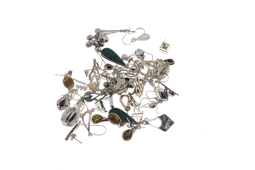 Lot 4 - A selection of silver and white metal earrings. To include three pairs of drop style earrings one an
