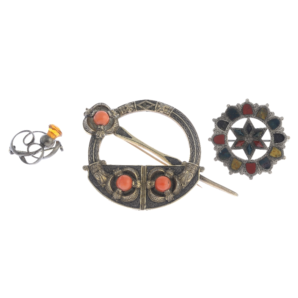 Lot 24 - Nine mainly Scottish silver and white metal brooches. To include a coral tara brooch featuring a