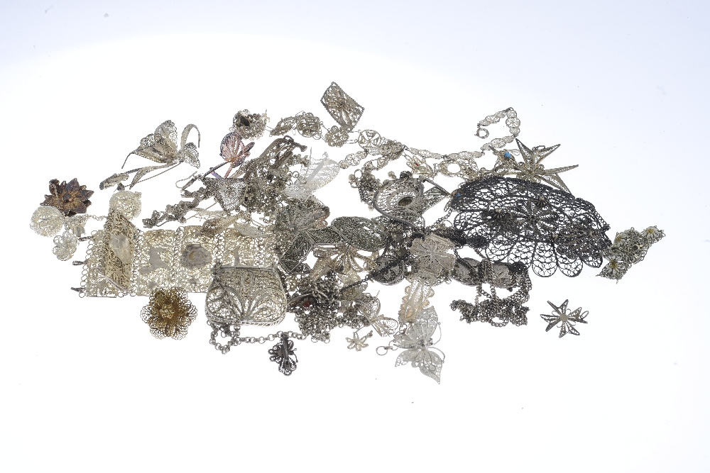 Lot 20 - A selection of silver and white metal filigree jewellery. To include three filigree brooches, one of