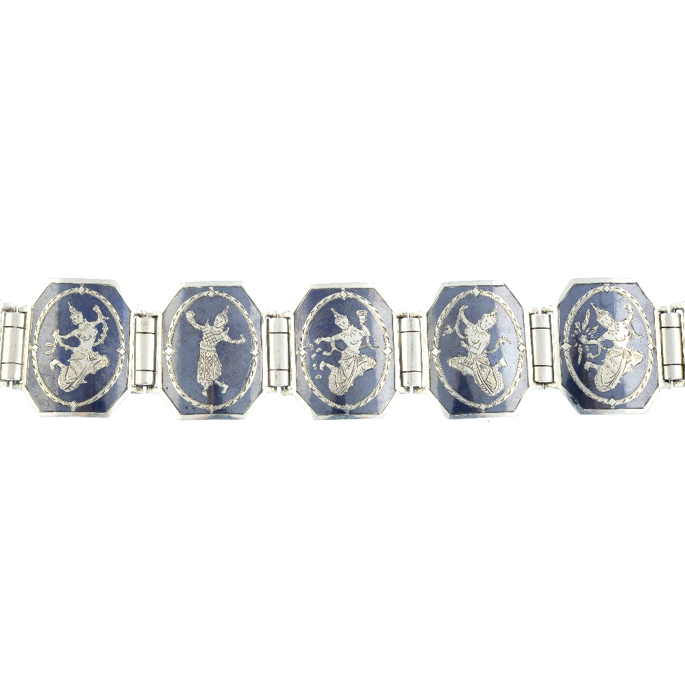 Lot 1 - Thirteen items of silver and white metal Siam jewellery. To include a niello bracelet featuring