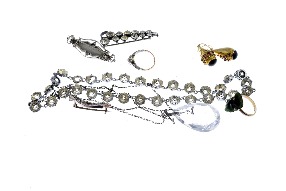 Lot 2 - A selection of silver and costume jewellery. To include an Edwardian silver Mizpah brooch, a