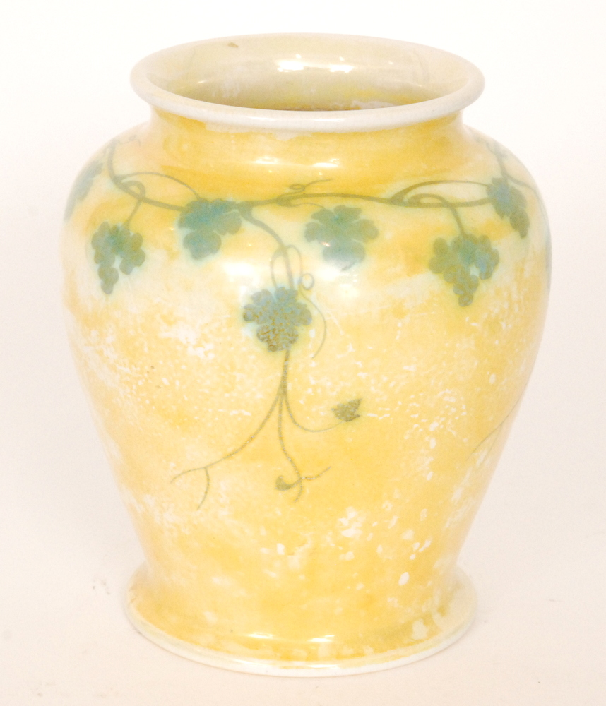 Lot 53 - A Ruskin Pottery yellow lustre footed vase decorated with a garland of hand painted ivy to the