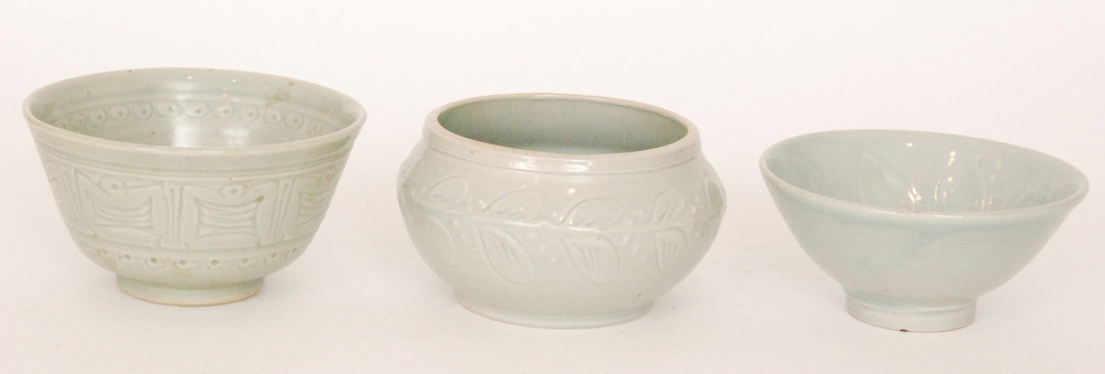 Lot 42 - Three studio pottery footed bowls each in a celadon glaze with incised decoration,