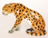 Lot 34 - A Beswick figure of a seated leopard, model 841, gloss, impressed marks, height 18cm, S/D.