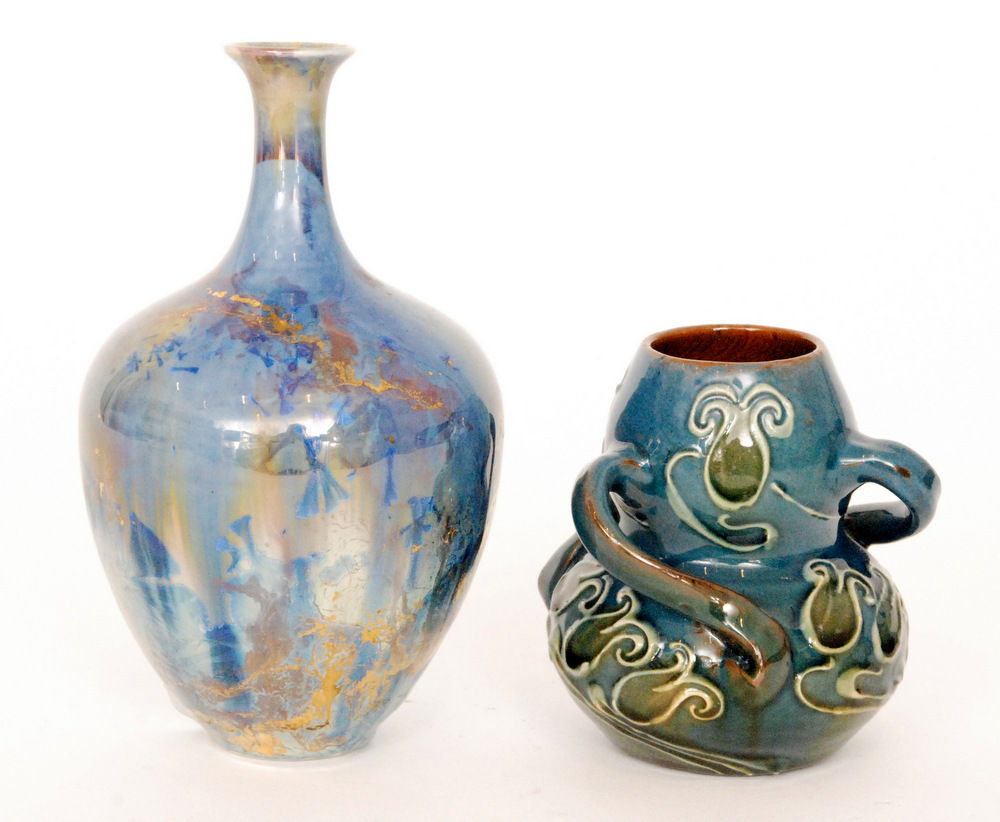 Lot 14 - A small late 19th Century Barum Pottery double gourd vase with three wrythen handles and decorated