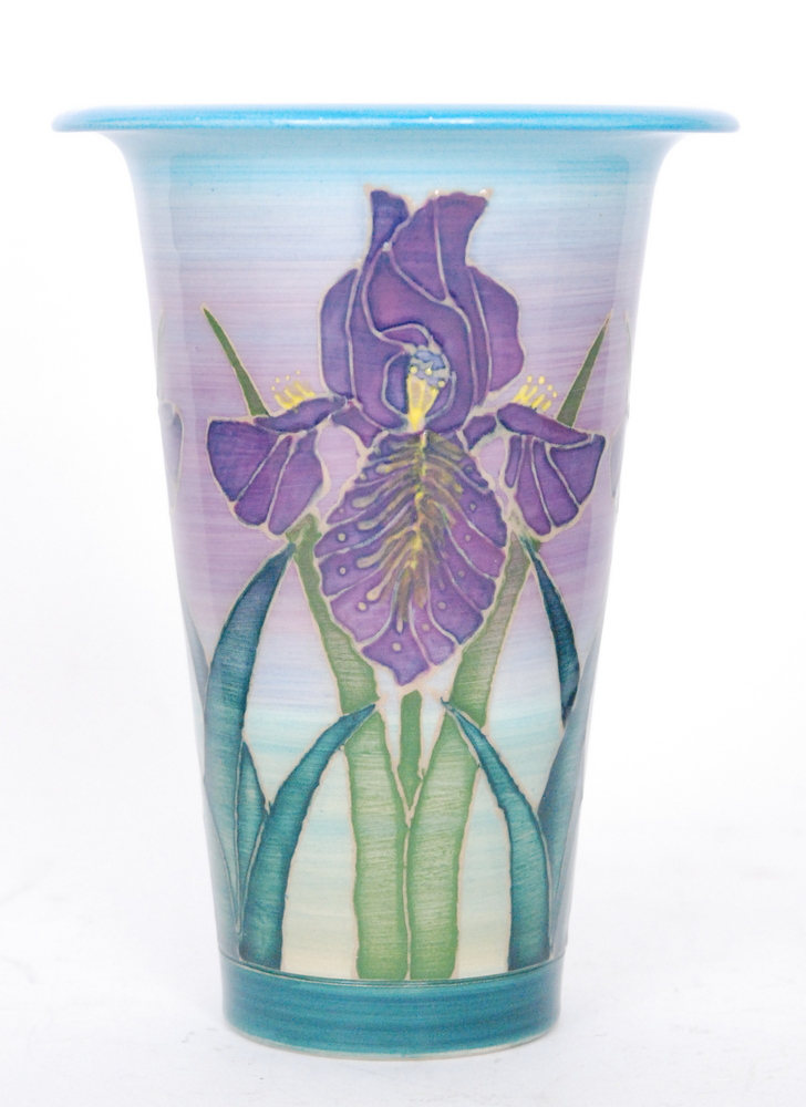 Lot 46 - A Dennis China Works trumpet vase decorated with tubelined purple iris against a tonal blue and