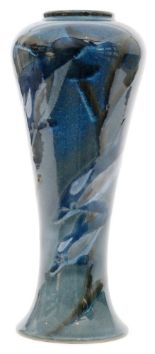 Lot 56 - A large Cobridge Pottery Stoneware vase decorated in the Ocean Traveller pattern with dolphins and