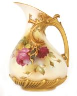 Lot 61 - A Royal Worcester shape 1439 ewer decorated with hand painted crimson roses against a pale ground,