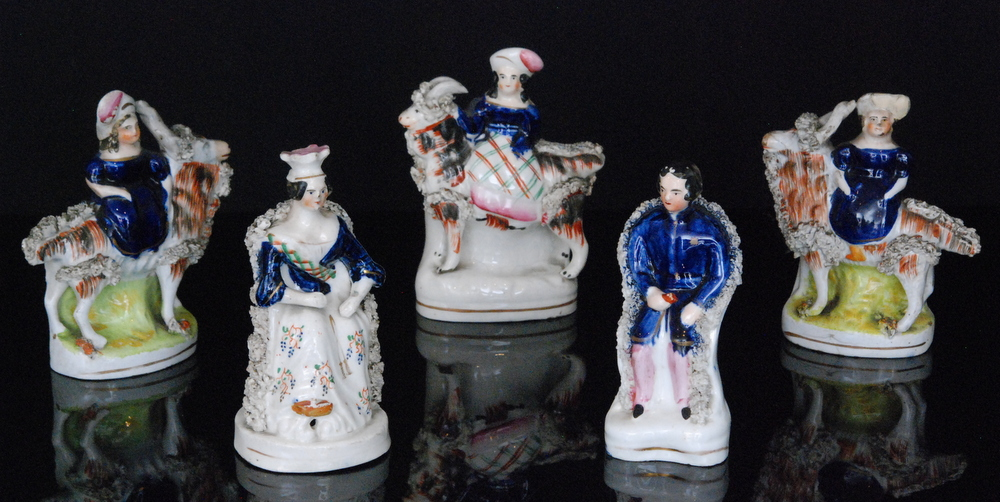 Lot 35 - A pair of 19th Century Staffordshire figures modelled as the young Queen Victoria and Prince Albert,