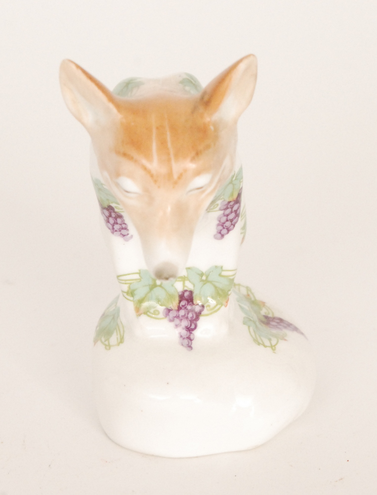 Lot 19 - An early 20th Century Royal Doulton model of a seated fox with a wide grinning face,