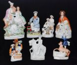 Lot 37 - A collection of assorted 19th Century Staffordshire figures and flatbacks to include a figure of a