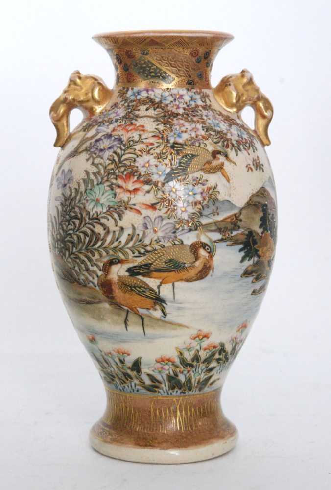 Lot 21 - A late 19th to early 20th Century Japanese Satsuma vase with moulded elephant head handles,
