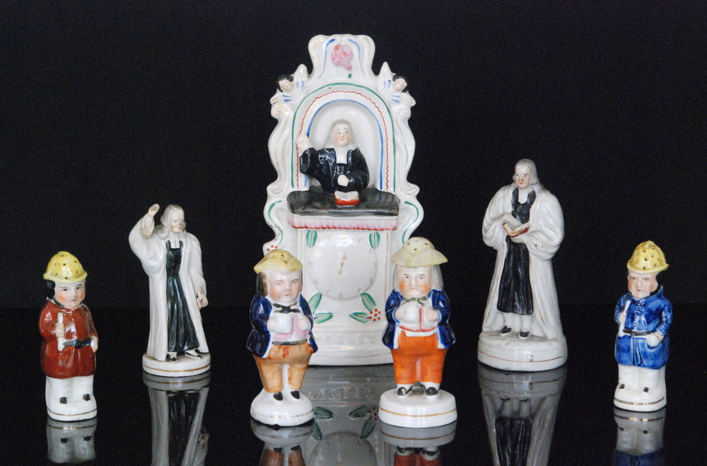 Lot 39 - A 19th Century Staffordshire Wesleyan figure modelled as Wesley sat in the pulpit with a painted
