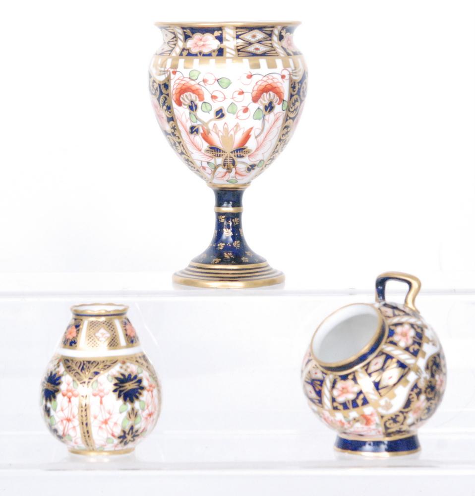 Lot 49 - Three pieces of Royal Crown Derby Imari comprising a pedestal vase in 6299,