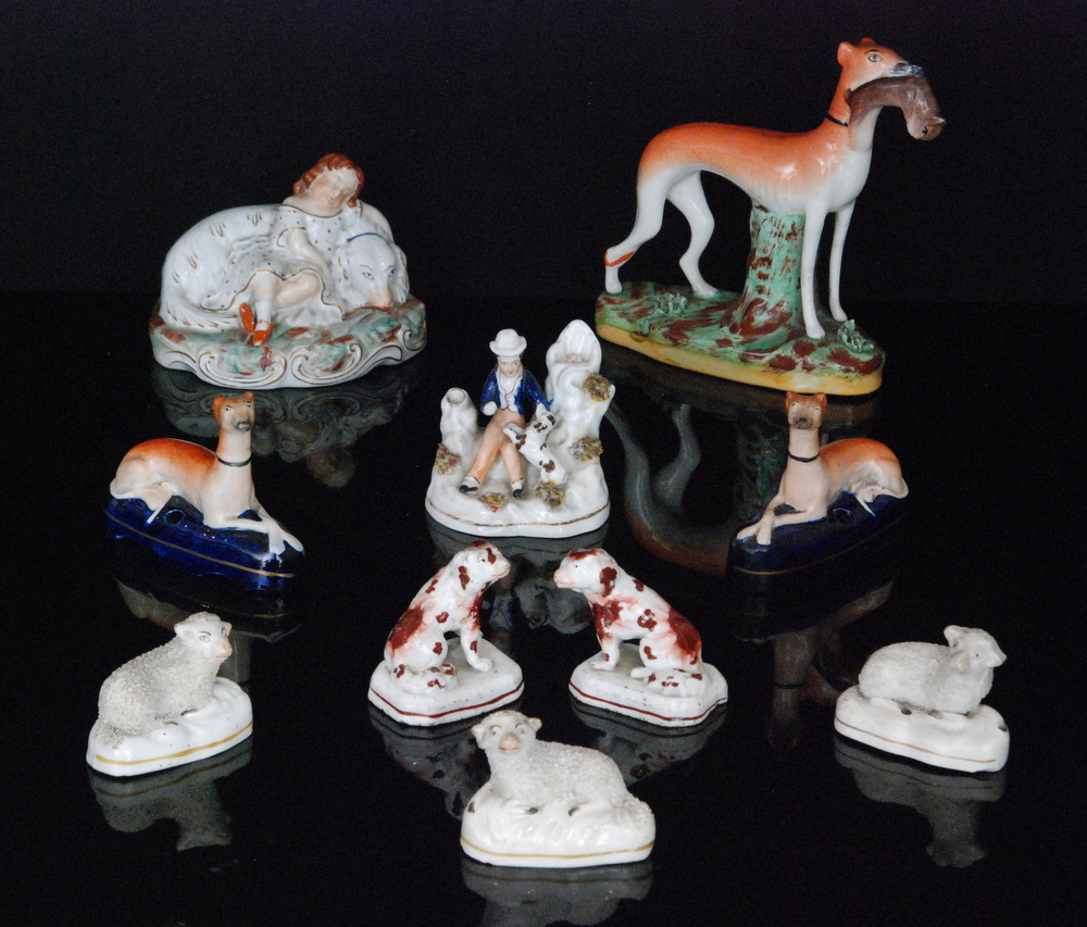 Lot 36 - A collection of 19th Century Staffordshire figures to include three encrusted models of sheep,