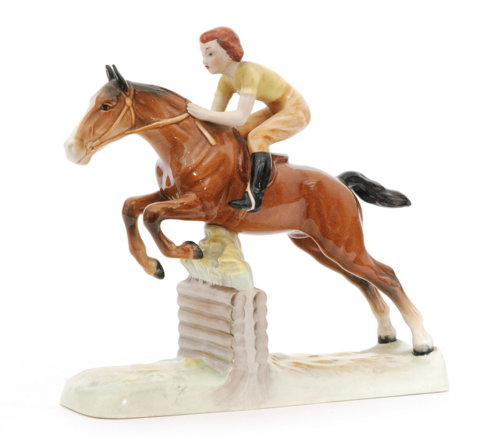 Lot 2 - A Beswick Pottery figure of a Girl on a Jumping Horse, model 939, circle mark, height 25cm.