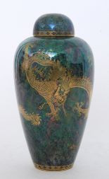 Lot 12 - A 1920s Wedgwood 'Ordinary Lustre' Malfrey pot of high shouldered form with a domed cover decorated