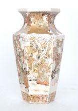Lot 20 - A late 19th Century Japanese Satsuma vase of hexagonal form decorated with scenes of robed figures