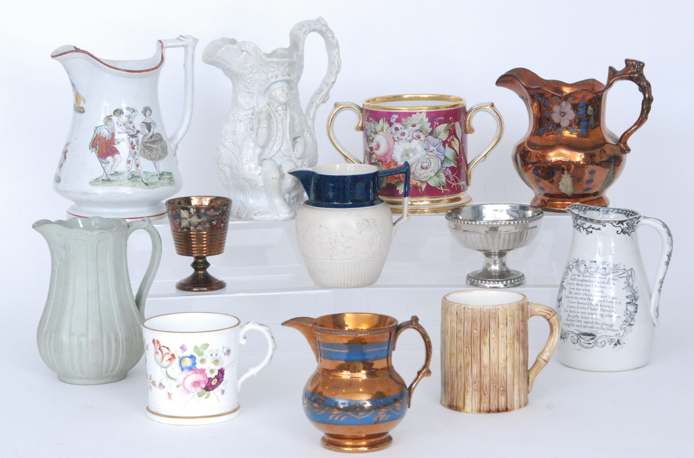 Lot 38 - A collection of assorted 19th Century Staffordshire mugs and jugs to include copper lustre examples,